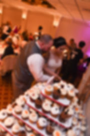 Justine and Jon cut their wedding cake during their October 2018 wedding reception at Twelve Acres in Smithfield, Rhode Island.