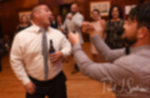 Guests dance during Meghan & Brian's September 2018 wedding reception at Squantum Association in Riverside, Rhode Island.
