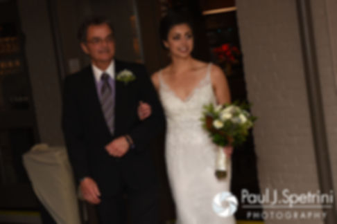 Gina is walked down the aisle by her father during her December 2016 wedding ceremony at the Waterman Grille in Providence, Rhode Island.