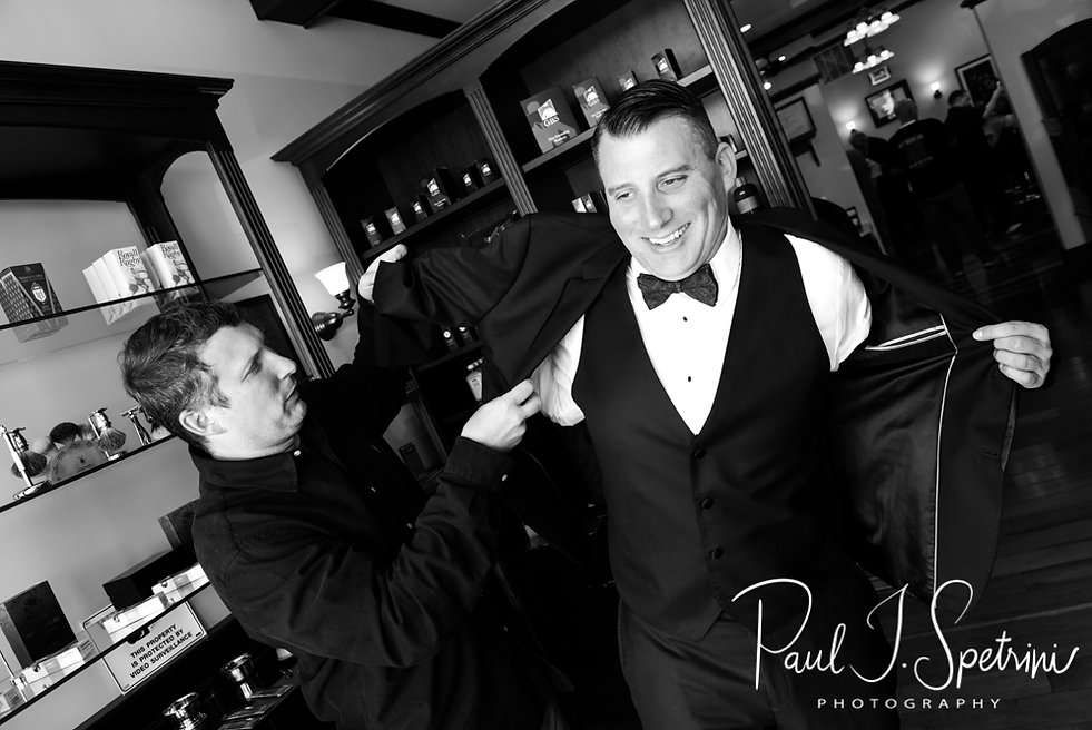 Brian puts his jacket on prior to his September 2018 wedding ceremony, at Gents Barbershop and Spa in Cranston, Rhode Island.