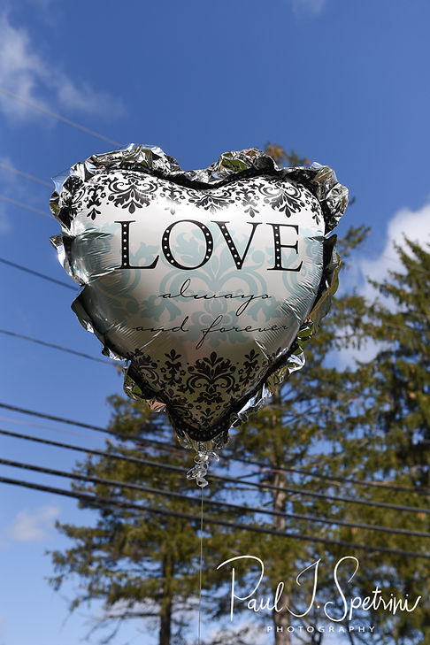 A balloon hangs outdoors prior to Nate & Kaytii's May 2018 wedding ceremony at Meadowbrook Inn in Charlestown, Rhode Island.