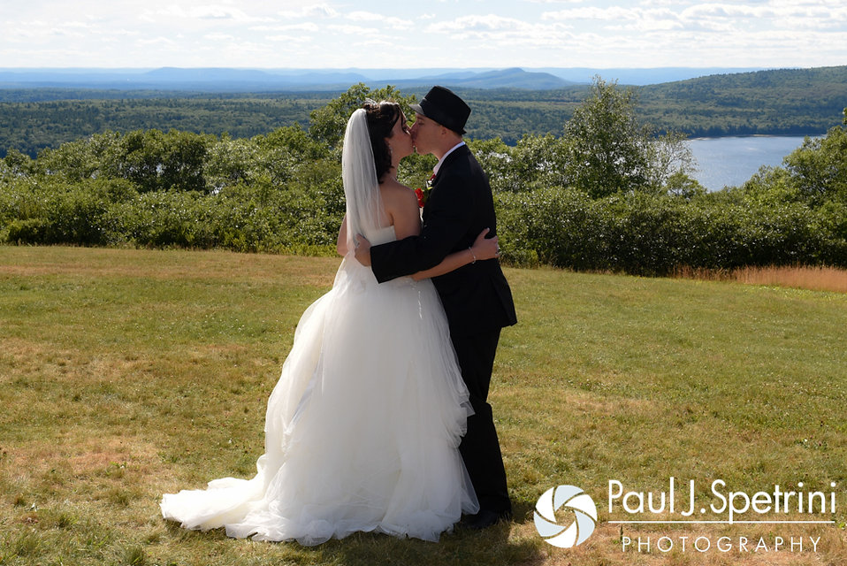 Amanda and Chris share their first kiss as husband and wife during their summer wedding at the Quabbin Reservoir Observation Tower in Belchertown, Massachusetts on July 2nd, 2016.