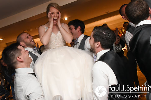 Melissa is lifted in the air as part of the traditional Hora celebration during her May 2017 wedding reception at Independence Harbor in Assonet, Massachusetts.