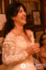 Samantha laughs during her October 2017 wedding reception at the Golden Lamb Buttery in Brooklyn, Connecticut.