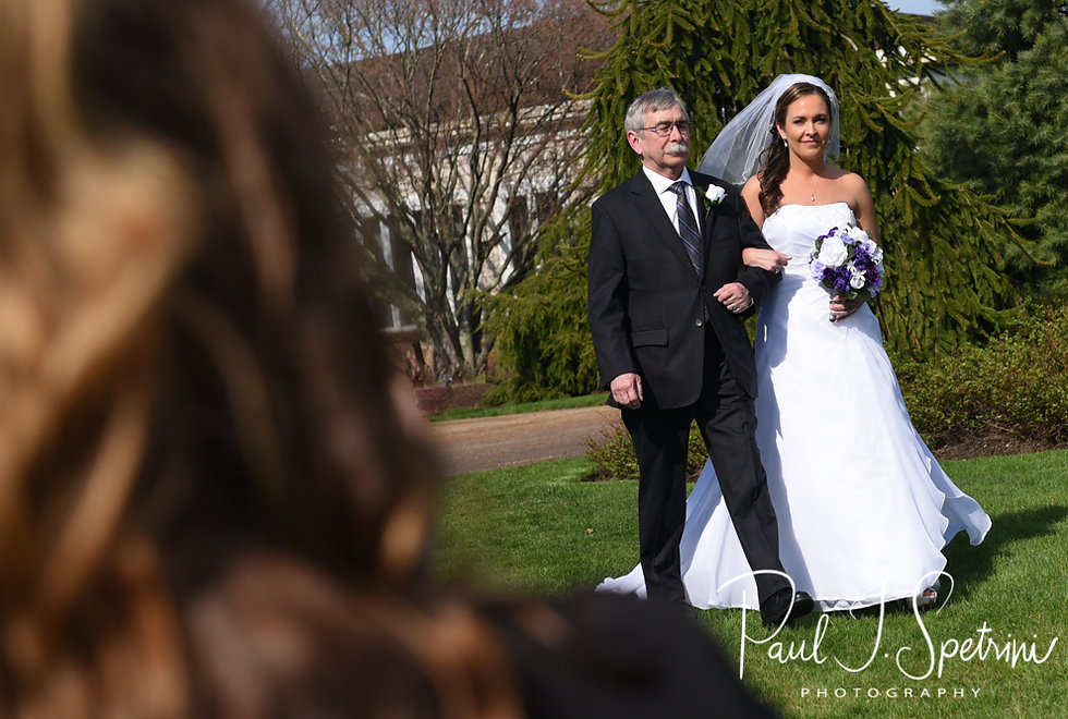 Katie walks down the aisle during her April 2018 wedding ceremony at Quidnessett Country Club in North Kingstown, Rhode Island.