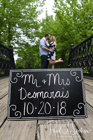 Sarah & Anthony pose for a photo during their June 2018 engagement session on the Iron Footbridge at Roger Williams Park in Providence, Rhode Island.