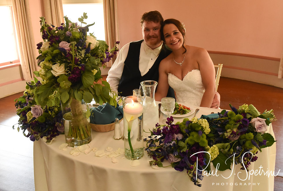 Danielle and Mark pose for a photo at their sweetheart table during their August 2018 wedding reception at the Roger Williams Park Casino in Providence, Rhode Island.