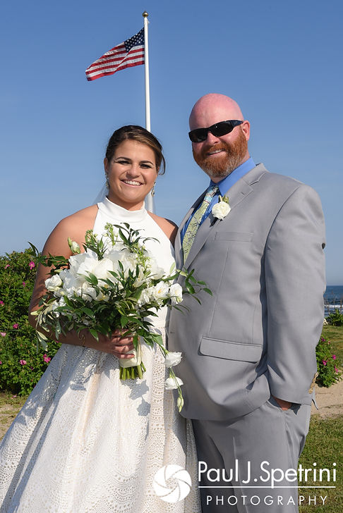 Molly and Tim pose for a formal photo prior to their June 2017 wedding reception at Farmhouse-By-The-Sea in Matunuck, Rhode Island.
