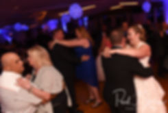 Patrick & Courtney dance with guests during their September 2018 wedding reception at Valley Country Club in Warwick, Rhode Island.