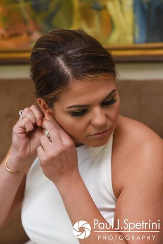Molly adjusts her earrings prior to her June 2017 wedding ceremony at Saint Romuald Chapel in Matunuck, Rhode Island.