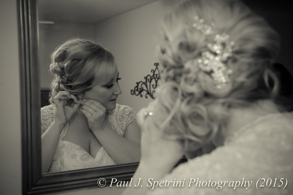 Kerry puts her earrings on prior to her fall wedding at Quidnessett Country Club in North Kingstown, Rhode Island on October 23rd, 2015.