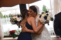 Aileen hugs a bridesmaid following her December 2018 wedding ceremony at McGoverns on the Water in Fall River, Massachusetts.