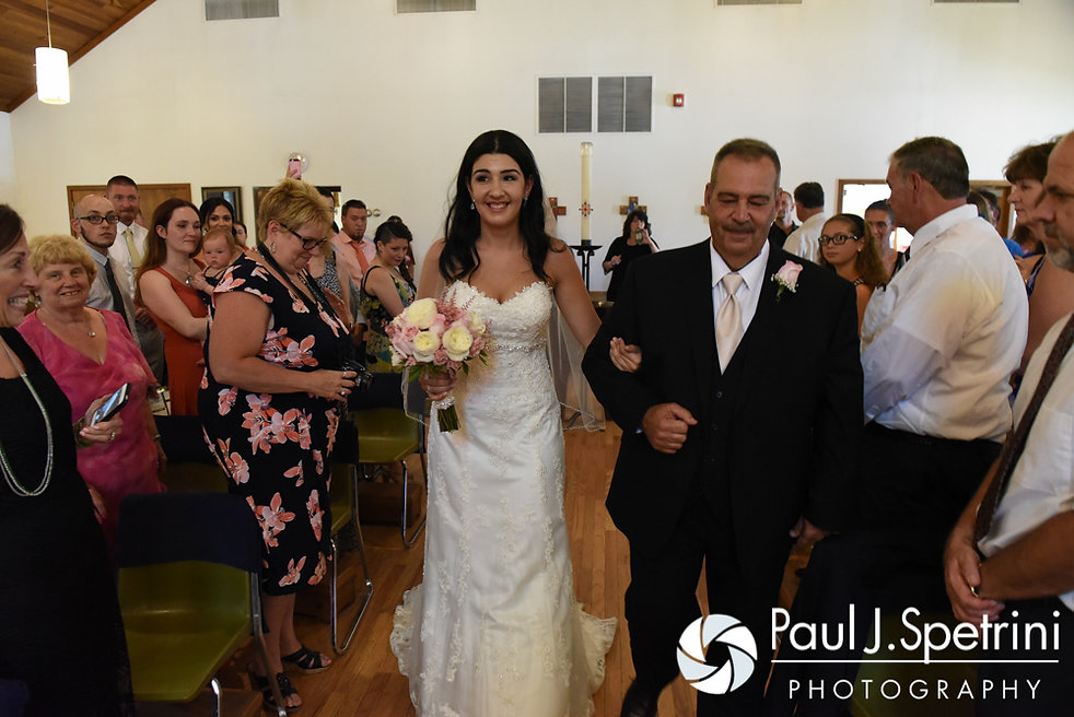 Lauryn walks down the aisle with her father during her July 2016 wedding at St. Paul the Apostle Catholic Church in Foster, Rhode Island.