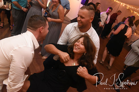 Guests dance during Amanda & Justin's November 2018 wedding reception at Five Bridge Inn in Rehoboth, Massachusetts.
