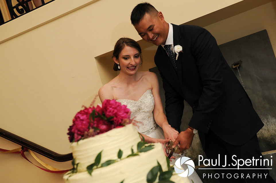 Dan and Simonne cut the cake during their June 2016 wedding in Providence, Rhode Island.