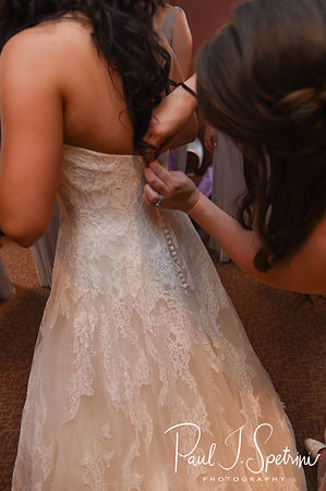 Nicole has her dress zipped up prior to her September 2018 wedding ceremony at The Towers in Narragansett, Rhode Island.