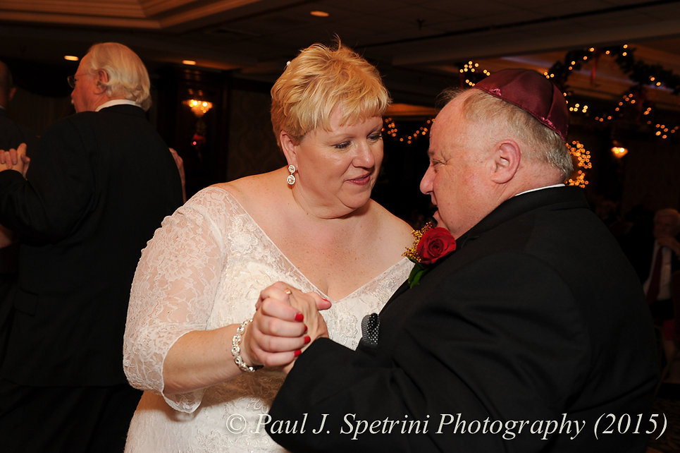 Cathy and Ron share a moment on the dance floor during their December 2015 Rhode Island wedding at Quidnessett Country Club in North Kingstown, RI.