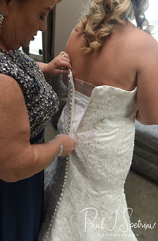Sarah has her dress zipped up during her bridal prep session at The Omni Hotel in Providence, Rhode Island prior to her October 2018 wedding.