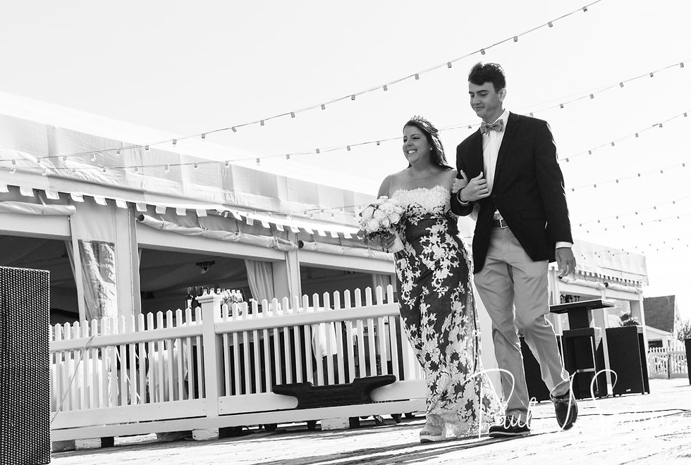 Kate and her son walk down the aisle prior to her May 2018 wedding ceremony aboard the Schooner Aurora boat in the waters off Newport, Rhode Island.