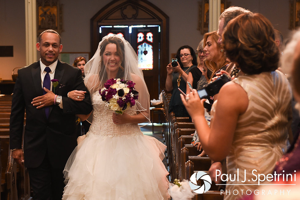 Stephanie walks down the aisle during her October 2016 wedding ceremony at the Historic St. Joseph Church in Cumberland, Rhode Island.