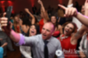 Guests party during Michelle and Eric's May 2016 wedding at Hillside Country Club in Rehoboth, Massachusetts.