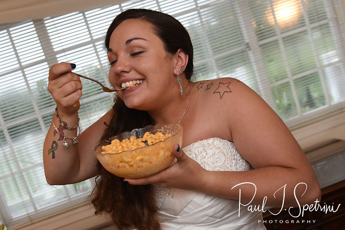 Laura eats macaroni and cheese during her June 2018 wedding reception at Independence Harbor in Assonet, Massachusetts.