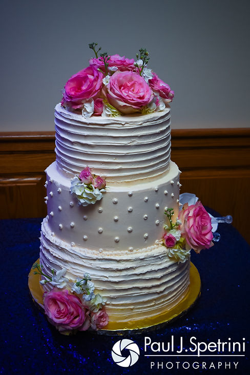 A look at the wedding cake on display during Jennifer and Mark's September 2016 wedding reception at the RI Shriners and Imperial Room at Rhodes Place in Providence, Rhode Island.