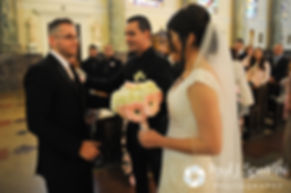 Maria's brother hands her off to Sebastian during Maria and Sebastian's March 2016 Rhode Island wedding at the Church of St. John the Baptist in Pawtucket, Rhode Island.