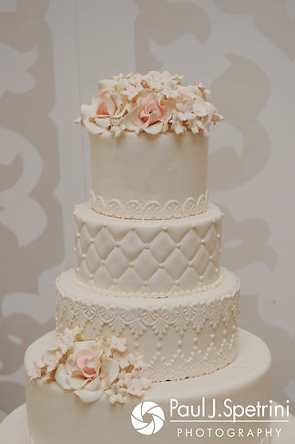 A look at Nashua and Nader's wedding cake, on display during their July 2017 wedding reception at Belle Mer in Newport, Rhode Island.