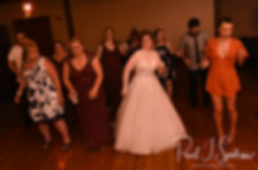 Kelly dances with guests during her June 2018 wedding reception at Blissful Meadows Golf Club in Uxbridge, Massachusetts.