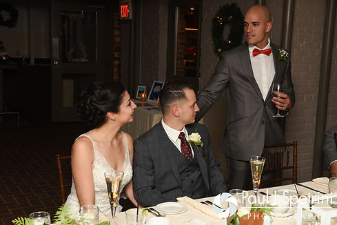 David's best man gives a speech during Gina and David's December 2016 wedding reception at the Waterman Grille in Providence, Rhode Island.