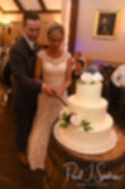 Nicole & Kurt cut their wedding cake during their November 2018 wedding reception at the Publick House Historic Inn in Sturbridge, Massachusetts.