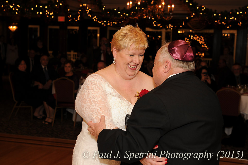 Cathy and Ron have their first dance as man and wife during their December 2015 Rhode Island wedding at Quidnessett Country Club in North Kingstown, RI.