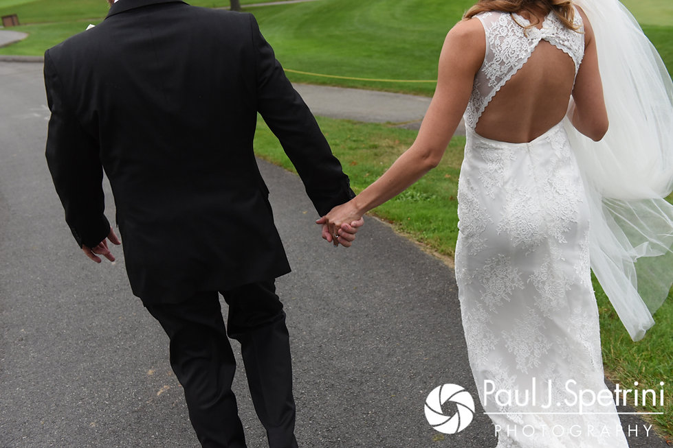 Kevin and Joanna hold hands for a formal photo following their October 2017 wedding ceremony at Cranston Country Club in Cranston, Rhode Island.