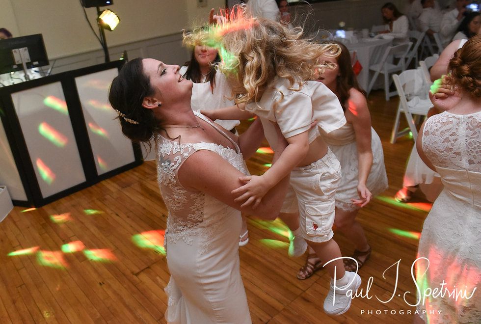 Selah dances with her ringbearer during her August 2018 wedding reception at The Rotunda Ballroom at Easton's Beach in Newport, Rhode Island.