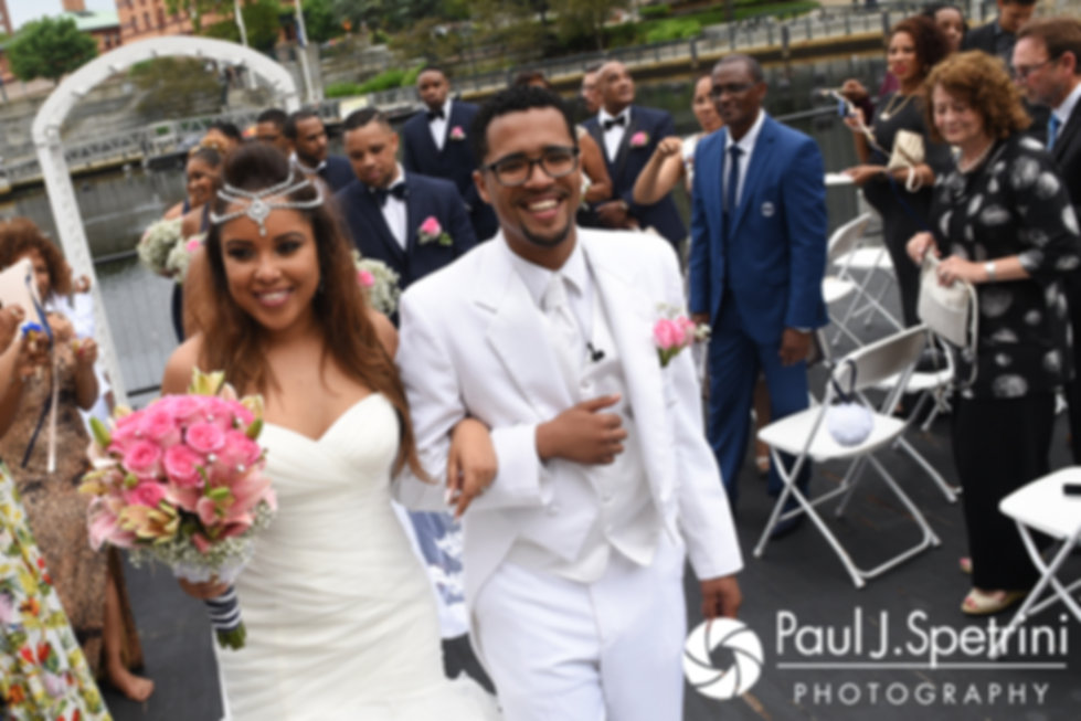 Lucelene and Luis walk down the aisle following their June 2017 wedding ceremony at Waterplace Park in Providence, Rhode Island.