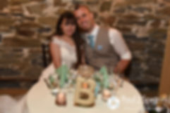 Krystal and Ian pose for a photo at the sweetheart table during their May 2016 wedding reception at DeWolf Tavern in Bristol, Rhode Island.