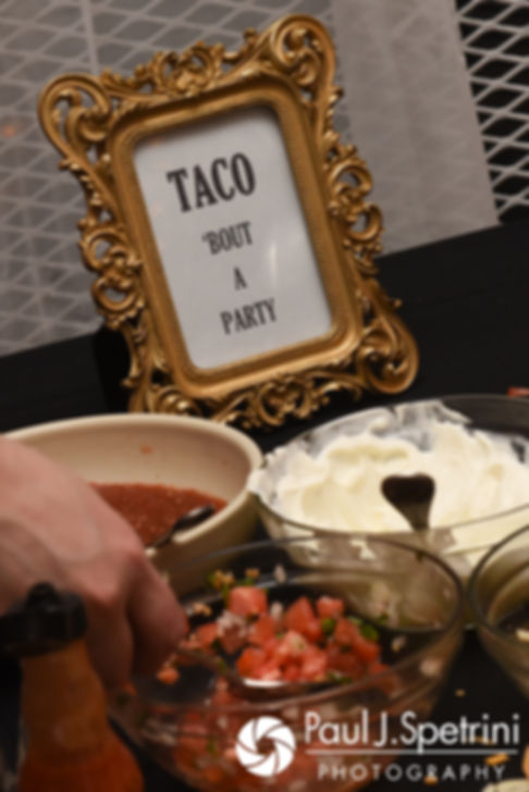 A sign at the food table is on display during Matthew and Meridith's May 2017 wedding reception at the Hope Artiste Village in Pawtucket, Rhode Island.