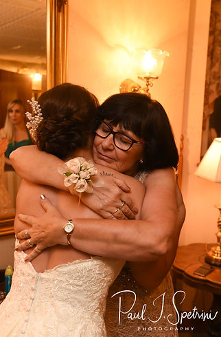 Danielle and her mother hug prior to her August 2018 wedding ceremony at the Roger Williams Park Casino in Providence, Rhode Island.
