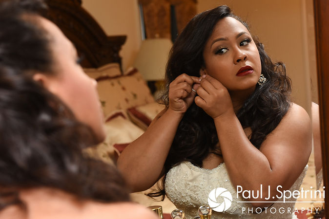 Stephany puts her earrings on prior to her September 2017 wedding ceremony at Wannamoisett Country Club in Rumford, Rhode Island.
