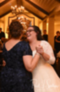 Katie and her mother dance during her October 2018 wedding reception at The Villa at Ridder Country Club in East Bridgewater, Massachusetts.