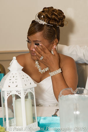 Jean Andrade reacts to her matron-of-honor's toast.