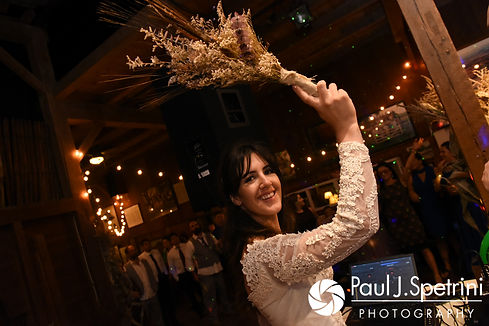 Samantha gets ready to toss the bouquet during her October 2017 wedding reception at the Golden Lamb Buttery in Brooklyn, Connecticut.