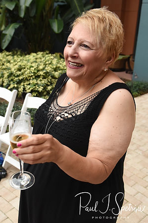 The mother of the groom gives a toast following Amanda & Josh's October 2018 wedding ceremony at the Walt Disney World Swan & Dolphin Resort in Lake Buena Vista, Florida.