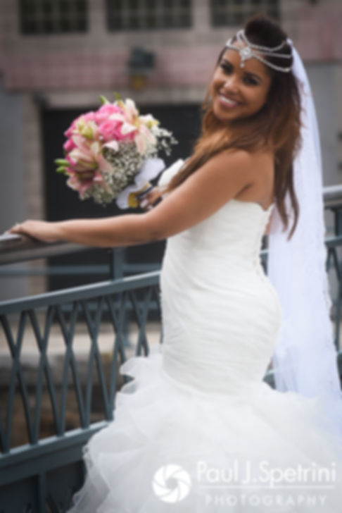 Lucelene smiles for a photo following her June 2017 wedding ceremony at Waterplace Park in Providence, Rhode Island.