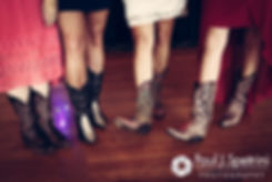 Heather and several of her guests show off their cowboy boots during Heather and John's July 2016 wedding reception at Crystal Lake Golf Club in Burrillville, Rhode Island.