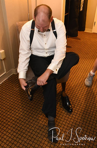 Bob puts his shoes on prior to his August 2018 wedding ceremony at the Walter J. Dempsey Memorial Bandstand in Norwood, Massachusetts.
