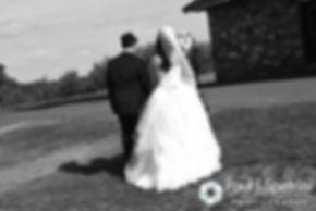 Amanda and Chris exit their summer wedding at the Quabbin Reservoir Observation Tower in Belchertown, Massachusetts on July 2nd, 2016.