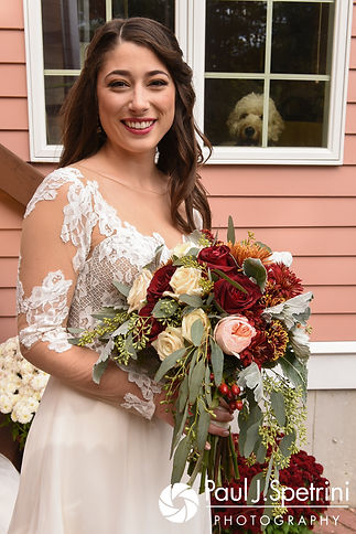 Jessica smiles for a photo prior to her October 2017 wedding ceremony at the Assumption of the Blessed Virgin Mary Church in Providence, Rhode Island.