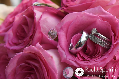 A look at Lucelene and Luis' wedding rings and flowers, shown during their June 2017 wedding reception at Al's Waterfront Restaurant in East Providence, Rhode Island.